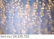 Купить «blurred christmas holidays lights bokeh», фото № 24235722, снято 15 октября 2016 г. (c) Syda Productions / Фотобанк Лори