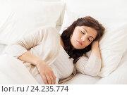 Купить «happy pregnant woman sleeping in bed at home», фото № 24235774, снято 20 мая 2016 г. (c) Syda Productions / Фотобанк Лори