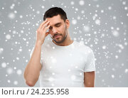 Купить «young man suffering from headache over snow», фото № 24235958, снято 15 января 2016 г. (c) Syda Productions / Фотобанк Лори