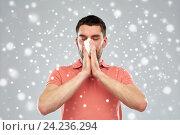 Купить «sick man with paper wipe blowing nose over snow», фото № 24236294, снято 15 января 2016 г. (c) Syda Productions / Фотобанк Лори