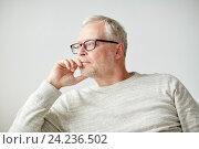 Купить «close up of senior man in glasses thinking», фото № 24236502, снято 7 июля 2016 г. (c) Syda Productions / Фотобанк Лори