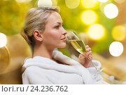 Купить «beautiful young woman drinking champagne at spa», фото № 24236762, снято 15 декабря 2014 г. (c) Syda Productions / Фотобанк Лори