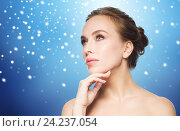 Купить «beautiful young woman touching her face over snow», фото № 24237054, снято 14 апреля 2016 г. (c) Syda Productions / Фотобанк Лори