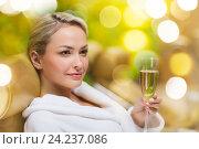 Купить «beautiful young woman drinking champagne at spa», фото № 24237086, снято 15 декабря 2014 г. (c) Syda Productions / Фотобанк Лори