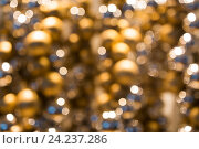 Купить «golden christmas decoration or garland of beads», фото № 24237286, снято 3 ноября 2016 г. (c) Syda Productions / Фотобанк Лори