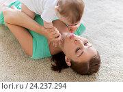 Купить «happy mother playing with little baby at home», фото № 24237294, снято 12 июля 2016 г. (c) Syda Productions / Фотобанк Лори