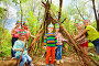 Happy kids building Injun's wigwam in the forest, фото № 24241662, снято 9 мая 2016 г. (c) Сергей Новиков / Фотобанк Лори