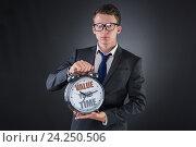 Купить «Young businessman time importance concept», фото № 24250506, снято 11 августа 2016 г. (c) Elnur / Фотобанк Лори