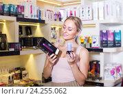 Купить «adult girl choosing toys in sex shop», фото № 24255062, снято 19 февраля 2020 г. (c) Яков Филимонов / Фотобанк Лори