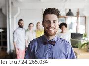 Купить «happy young man over creative team in office», фото № 24265034, снято 29 марта 2015 г. (c) Syda Productions / Фотобанк Лори