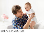 Купить «happy young father with little baby at home», фото № 24265170, снято 12 июля 2016 г. (c) Syda Productions / Фотобанк Лори