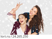 Купить «happy pretty teenage girls showing peace hand sign», фото № 24265250, снято 19 декабря 2015 г. (c) Syda Productions / Фотобанк Лори