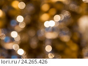 Купить «blurred golden christmas lights bokeh», фото № 24265426, снято 3 ноября 2016 г. (c) Syda Productions / Фотобанк Лори