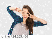 Купить «happy smiling teenage girl showing peace sign», фото № 24265466, снято 19 декабря 2015 г. (c) Syda Productions / Фотобанк Лори