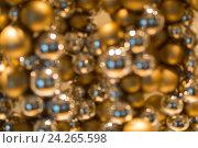 Купить «golden christmas decoration or garland of beads», фото № 24265598, снято 3 ноября 2016 г. (c) Syda Productions / Фотобанк Лори