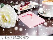 Купить «close up of greeting card with heart and coffee», фото № 24265670, снято 1 декабря 2015 г. (c) Syda Productions / Фотобанк Лори