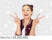 Купить «happy smiling teenage girl showing peace sign», фото № 24265682, снято 19 декабря 2015 г. (c) Syda Productions / Фотобанк Лори