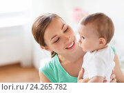 Купить «happy young mother with little baby at home», фото № 24265782, снято 12 июля 2016 г. (c) Syda Productions / Фотобанк Лори