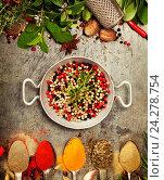 Купить «Пряные травы и набор специй», фото № 24278754, снято 4 октября 2016 г. (c) Наталия Кленова / Фотобанк Лори