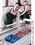Купить «Two sellers of frozen fish», фото № 24282770, снято 26 июня 2019 г. (c) Яков Филимонов / Фотобанк Лори