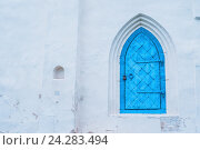 Купить «Architecture background of architecture element- aged dark blue metal forged door with arcade on the white stone wall», фото № 24283494, снято 19 августа 2016 г. (c) Зезелина Марина / Фотобанк Лори