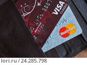 Купить «Расчетные банковские карты Visa и Mastercard», фото № 24285798, снято 29 ноября 2016 г. (c) Victoria Demidova / Фотобанк Лори