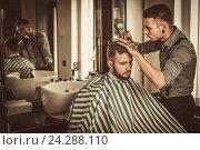 Confident man visiting hairstylist in barber shop., фото № 24288110, снято 10 июня 2016 г. (c) Andrejs Pidjass / Фотобанк Лори