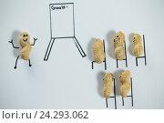 Conceptual image of peanut figurines attending a official meeting. Стоковое фото, агентство Wavebreak Media / Фотобанк Лори
