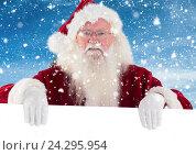 Купить «Santa clause holding white placard», фото № 24295954, снято 21 октября 2018 г. (c) Wavebreak Media / Фотобанк Лори