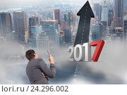 Купить «2017 against a composite image of business man looking at road leading towards sky», фото № 24296002, снято 13 декабря 2017 г. (c) Wavebreak Media / Фотобанк Лори