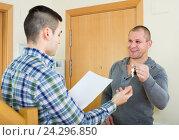 Купить «Realtor giving keys to flat owner», фото № 24296850, снято 15 августа 2018 г. (c) Яков Филимонов / Фотобанк Лори