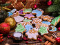 Christmas gingerbread cookies on woden table and candels., фото № 24305942, снято 30 ноября 2016 г. (c) Gennadiy Poznyakov / Фотобанк Лори