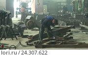 Купить «Welder at work in factory», видеоролик № 24307622, снято 10 сентября 2015 г. (c) Иван Карпов / Фотобанк Лори