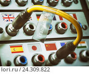 Купить «Translator. Select language. Learning, translate languages concept. Audio input output control panel with flags and plug.», фото № 24309822, снято 16 февраля 2019 г. (c) Maksym Yemelyanov / Фотобанк Лори