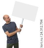 Купить «Молодой человек с плакатом на белом фоне», фото № 24312794, снято 3 сентября 2016 г. (c) Александр Лычагин / Фотобанк Лори