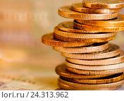 Купить «Стопка монет разных стран, тональная коррекция, желтый цвет», фото № 24313962, снято 3 апреля 2016 г. (c) Екатерина Овсянникова / Фотобанк Лори
