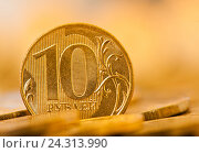Купить «Монета номиналом в десять рублей (крупный план), тональная коррекция, желтый цвет», фото № 24313990, снято 23 июля 2016 г. (c) E. O. / Фотобанк Лори