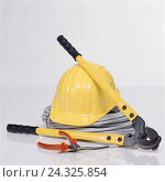 Купить «yellow safety helmet on cable role with big and small liers», фото № 24325854, снято 22 мая 2019 г. (c) mauritius images / Фотобанк Лори