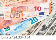 Money background from american dollars and euro banknotes, фото № 24334134, снято 4 декабря 2016 г. (c) FotograFF / Фотобанк Лори