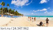 Купить «Coconut trees and white beach at the turquoise sea, Playa Bavaro, Punta Cana, La Altagracia province, the Dominican Republic, the Greater Antilles, the Caribbean», фото № 24347962, снято 16 августа 2018 г. (c) mauritius images / Фотобанк Лори