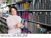 Купить «Female choosing hair dye», фото № 24365254, снято 17 августа 2018 г. (c) Яков Филимонов / Фотобанк Лори