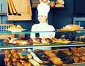 Girl cook gladly suggesting pastry, фото № 24365274, снято 7 декабря 2016 г. (c) Яков Филимонов / Фотобанк Лори