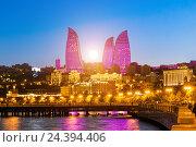 Купить «Красивый закат солнца между Огненными Башнями в Баку. Азербайджан», фото № 24394406, снято 22 сентября 2016 г. (c) Евгений Ткачёв / Фотобанк Лори