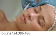Купить «Attractive girl on a cosmetic procedure», видеоролик № 24396486, снято 22 октября 2018 г. (c) Raev Denis / Фотобанк Лори