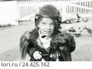 Купить «Girls, pedal car, helmet, half portrait, b/w, child, play, game, leisure time, activity, toys, crash helmet, view camera, outside, very close», фото № 24425162, снято 25 октября 2002 г. (c) mauritius images / Фотобанк Лори