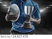 Купить «Composite image 3D of mid section of sportsman holding trophy and rugby ball», фото № 24427678, снято 27 июня 2019 г. (c) Wavebreak Media / Фотобанк Лори