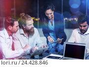 Купить «Businesswoman discussing with colleagues over digital tablet», фото № 24428846, снято 18 июня 2019 г. (c) Wavebreak Media / Фотобанк Лори