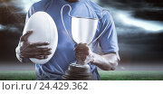Купить «Composite image 3D of mid section of sportsman holding trophy and rugby ball», фото № 24429362, снято 27 июня 2019 г. (c) Wavebreak Media / Фотобанк Лори