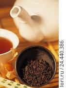 Купить «Chinese Pu erh tea in peel, cup with tea, teapot, Physalis, rods, near», фото № 24440386, снято 18 августа 2018 г. (c) mauritius images / Фотобанк Лори