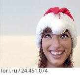 Купить «Woman, young, smile, there squint, Bommel, Santa's hat, portrait, young persons, happy, friendly, facial play, funnily, fun, lining, cap, headgear, for...», фото № 24451074, снято 21 февраля 2006 г. (c) mauritius images / Фотобанк Лори